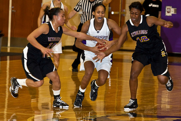 Pickerington North High School's #35 Kavunaa Edwards has her drive stopped in mid court by Reynoldsburg High School's #10 Whitney McKoy, left, and #42 Destini Cooper, right in the second quarter of play at Pickerington North High School Thursday night December 17, 2009. (Photo by James D. DeCamp 614-462-8027)