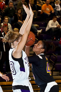Pickerington North High School's #23 Paige Stought blocks two points from Reynoldsburg High School's #44 T'Shera Lucas in the first quarter of play at Pickerington North High School Thursday night December 17, 2009. (Photo by James D. DeCamp 614-462-8027)