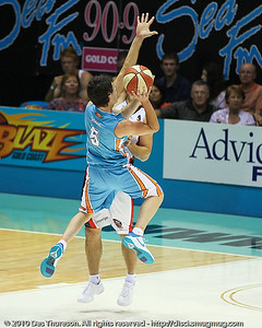 Jason Cadee elevates inside - Gold Coast Blaze v Perth Wildcats NBL Baskeball, New Year's Eve 2010; Gold Coast Convention & Exhibition Centre.