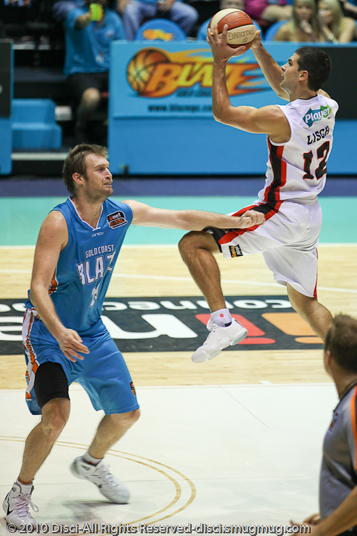 Kevin Lisch over Mark Worthington - Gold Coast Blaze v Perth Wildcats NBL Baskeball, New Year's Eve 2010; Gold Coast Convention & Exhibition Centre.