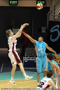 Darryl Hudson closes out on Cameron Tovey - Gold Coast Blaze v Perth Wildcats NBL Baskeball, New Year's Eve 2010; Gold Coast Convention & Exhibition Centre.