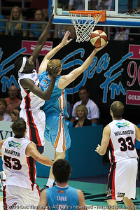 Tom Garlepp beats Ater Majok to the basket - Gold Coast Blaze v Perth Wildcats NBL Baskeball, New Year's Eve 2010; Gold Coast Convention & Exhibition Centre.