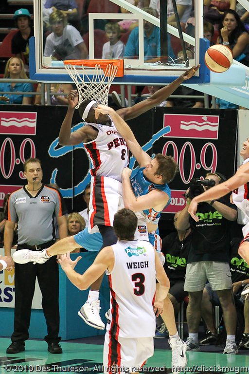 """Long"" Atek Majok skies for the block on Mark Worthington - Gold Coast Blaze v Perth Wildcats NBL Baskeball, New Year's Eve 2010; Gold Coast Convention & Exhibition Centre."