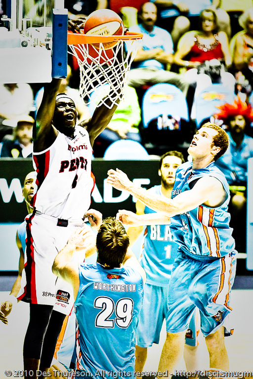 "Ater Majok beats Tom Garlepp & Mark Worthington to the hoop - Gold Coast Blaze v Perth Wildcats NBL Baskeball, New Year's Eve 2010; Gold Coast Convention & Exhibition Centre.  Alternate Processing - ""Hard Depth""."
