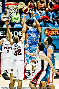 Alternate Processing - Dave Hill Temp - Ira Clark drives inside - Gold Coast Blaze v Perth Wildcats NBL Baskeball, New Year's Eve 2010; Gold Coast Convention & Exhibition Centre.