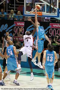 Mark Worthington defends Ater Majok's shot - Gold Coast Blaze v Perth Wildcats NBL Baskeball, New Year's Eve 2010; Gold Coast Convention & Exhibition Centre.