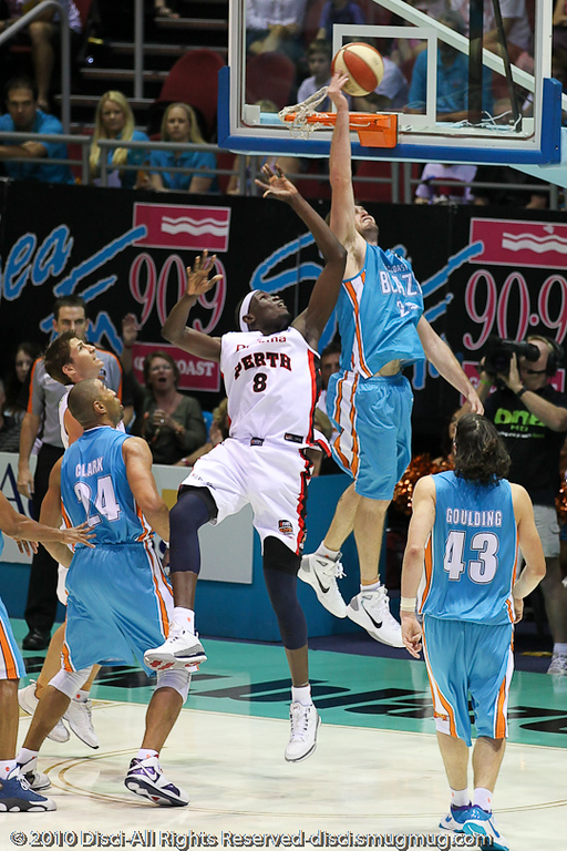 Mark Worthington defends Ater Majok's shot - Gold Coast Blaze v Perth Wildcats NBL Baskeball, New Year's Eve 2010; Gold Coast Convention & Exhibition Centre.
