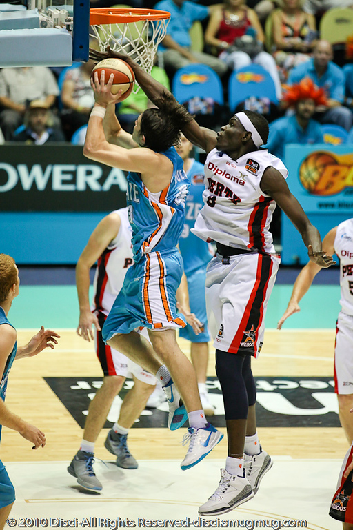 Ater Majok gets all of his hand & wrist and some of his forearm over the ball as Chris goulding drives to the basket - Gold Coast Blaze v Perth Wildcats NBL Baskeball, New Year's Eve 2010; Gold Coast Convention & Exhibition Centre.