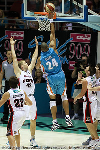 Ira Clark inside over Shawn Redhage - Gold Coast Blaze v Perth Wildcats NBL Baskeball, New Year's Eve 2010; Gold Coast Convention & Exhibition Centre.