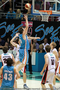 Mark Worthington inside over Stephen Weigh - Gold Coast Blaze v Perth Wildcats NBL Baskeball, New Year's Eve 2010; Gold Coast Convention & Exhibition Centre.