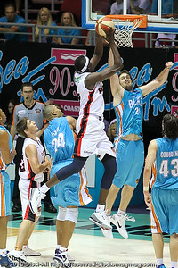 Ater Majok against Mark Worthington - Gold Coast Blaze v Perth Wildcats NBL Baskeball, New Year's Eve 2010; Gold Coast Convention & Exhibition Centre.