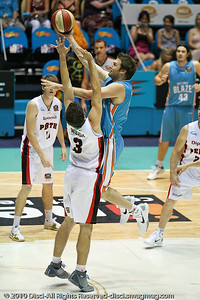 Mark Worthington shoots over Stephen Weigh - Gold Coast Blaze v Perth Wildcats NBL Baskeball, New Year's Eve 2010; Gold Coast Convention & Exhibition Centre.