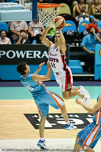 Kevin Lisch inside against Jason Cadee - Gold Coast Blaze v Perth Wildcats NBL Baskeball, New Year's Eve 2010; Gold Coast Convention & Exhibition Centre.