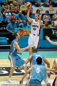 Shawn Redhage elevates over Mark Worthington - Gold Coast Blaze v Perth Wildcats NBL Baskeball, New Year's Eve 2010; Gold Coast Convention & Exhibition Centre.