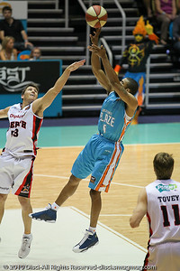 Darryl Hudson shoots over Damian Martin - Gold Coast Blaze v Perth Wildcats NBL Baskeball, New Year's Eve 2010; Gold Coast Convention & Exhibition Centre.