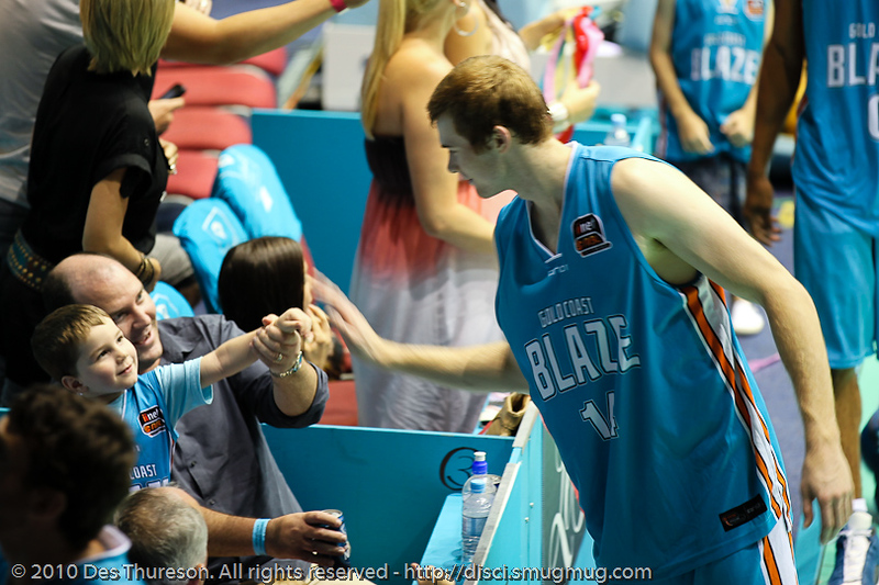 Tom Garlepp with a high five for the excited fan - Gold Coast Blaze v Perth Wildcats NBL Baskeball, New Year's Eve 2010; Gold Coast Convention & Exhibition Centre.