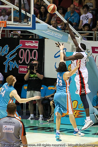 Ater Majok shoots over Chris Goulding - Gold Coast Blaze v Perth Wildcats NBL Baskeball, New Year's Eve 2010; Gold Coast Convention & Exhibition Centre.