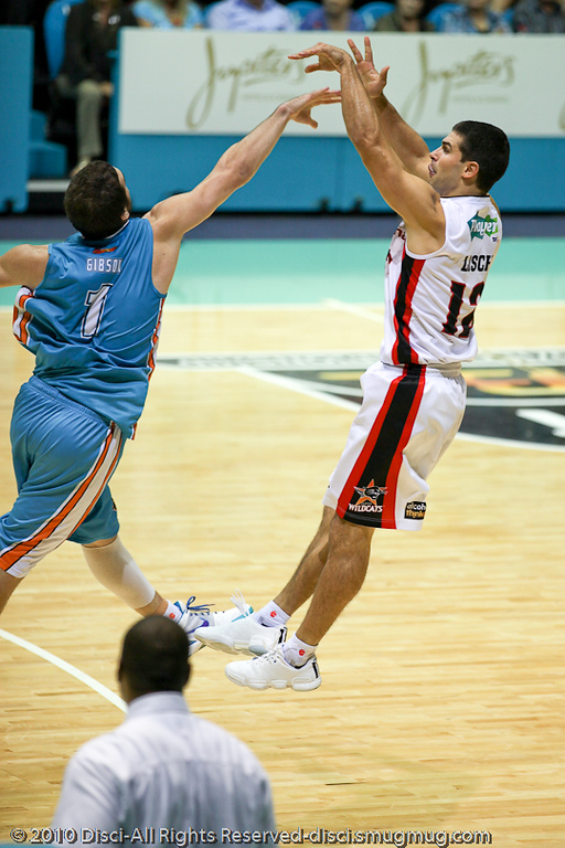 Kevin Lisch shoots over Adam Gibson - Gold Coast Blaze v Perth Wildcats NBL Baskeball, New Year's Eve 2010; Gold Coast Convention & Exhibition Centre.