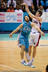 Cameron Tovey over Adam Gibson - Gold Coast Blaze v Perth Wildcats NBL Baskeball, New Year's Eve 2010; Gold Coast Convention & Exhibition Centre.