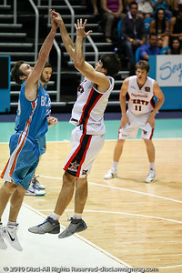 Blaze defender Adam Gibson closes out on Stephen Weigh - Gold Coast Blaze v Perth Wildcats NBL Baskeball, New Year's Eve 2010; Gold Coast Convention & Exhibition Centre.