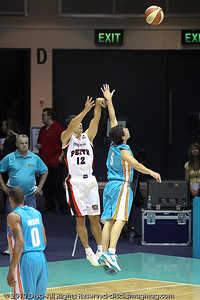 Jason Cadee closes out on Kevin Lisch -  Gold Coast Blaze v Perth Wildcats NBL Baskeball, New Year's Eve 2010; Gold Coast Convention & Exhibition Centre.