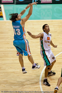 Chris Goulding over Michael Cedar - Gold Coast Blaze v Townsville Crocodiles NBL Basketball, Friday 17 December 2010 - National Basketball League, Gold Coast Convention & Exhibition Centre, Queensland, Australia. Photos by Des Thureson.