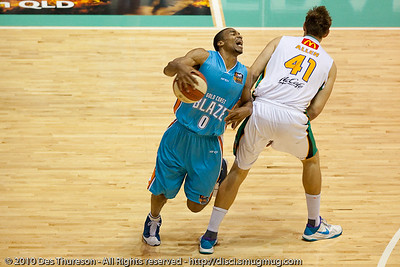 Blaze import Darryl Hudson does a good job of selling the foul committed by former St Mary's player Ben Allen - Gold Coast Blaze v Townsville Crocodiles NBL Basketball, Friday 17 December 2010 - National Basketball League, Gold Coast Convention & Exhibition Centre, Queensland, Australia. Photos by Des Thureson.