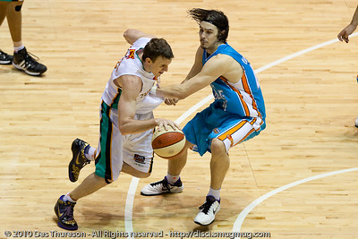 Chris Goulding up and in against Peter Crawford - Gold Coast Blaze v Townsville Crocodiles NBL Basketball, Friday 17 December 2010 - National Basketball League, Gold Coast Convention & Exhibition Centre, Queensland, Australia. Photos by Des Thureson.