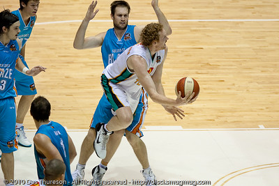 Luke Schenscher gets past Mark Worthington for the inside scoop shot - Gold Coast Blaze v Townsville Crocodiles NBL Basketball, Friday 17 December 2010 - National Basketball League, Gold Coast Convention & Exhibition Centre, Queensland, Australia. Photos by Des Thureson.