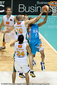 Russell Hinder fouls Darryl Hudson - Gold Coast Blaze v Townsville Crocodiles NBL Basketball, Friday 17 December 2010 - National Basketball League, Gold Coast Convention & Exhibition Centre, Queensland, Australia. Photos by Des Thureson.