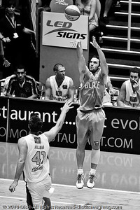 Adam Gibson v Ben Allen - Gold Coast Blaze v Townsville Crocodiles NBL Basketball, Friday 17 December 2010 - National Basketball League, Gold Coast Convention & Exhibition Centre, Queensland, Australia. Photos by Des Thureson. (Stark Raging Black Curve.)