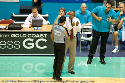 Blaze Head Coach, Joey Wright discusses a call with the NBL's top referee Scott Butler, as incredulous Blaze Assistant Coach Pero Cameron looks on - Gold Coast Blaze v Townsville Crocodiles NBL Basketball, Friday 17 December 2010 - National Basketball League, Gold Coast Convention & Exhibition Centre, Queensland, Australia. Photos by Des Thureson.
