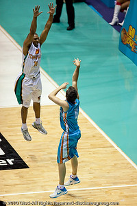 In his first game in the NBL after a nasty car accident and injury, rookie Jason Cadee strikes gold with his first 3 point attempt - Gold Coast Blaze v Townsville Crocodiles NBL Basketball, Friday 17 December 2010 - National Basketball League, Gold Coast Convention & Exhibition Centre, Queensland, Australia. Photos by Des Thureson.