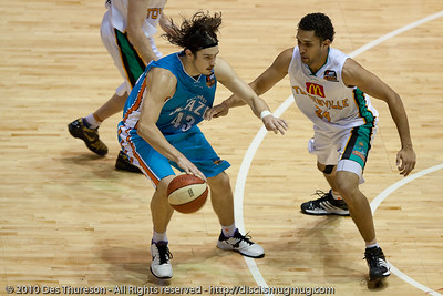 Chris Goulding v Michael Cedar - Gold Coast Blaze v Townsville Crocodiles NBL Basketball, Friday 17 December 2010 - National Basketball League, Gold Coast Convention & Exhibition Centre, Queensland, Australia. Photos by Des Thureson.