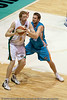 Mark Worthington defends Luke Schenscher - Gold Coast Blaze v Townsville Crocodiles NBL Basketball, Friday 17 December 2010 - National Basketball League, Gold Coast Convention & Exhibition Centre, Queensland, Australia. Photos by Des Thureson.