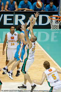 Chris Goulding drives over Russell Hinder - Gold Coast Blaze v Townsville Crocodiles NBL Basketball, Friday 17 December 2010 - National Basketball League, Gold Coast Convention & Exhibition Centre, Queensland, Australia. Photos by Des Thureson.