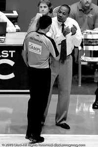Blaze Head Coach, Joey Wright discusses a call with the NBL's top referee Scott Butler - Gold Coast Blaze v Townsville Crocodiles NBL Basketball, Friday 17 December 2010 - National Basketball League, Gold Coast Convention & Exhibition Centre, Queensland, Australia. Photos by Des Thureson. - B&W Low Contrast.
