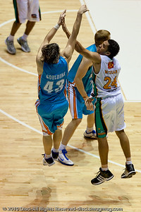 """Threeeee Points!"" - Chris Goulding scores on the 3 point buzzer beater leading into half time - Gold Coast Blaze v Townsville Crocodiles NBL Basketball, Friday 17 December 2010 - National Basketball League, Gold Coast Convention & Exhibition Centre, Queensland, Australia. Photos by Des Thureson."