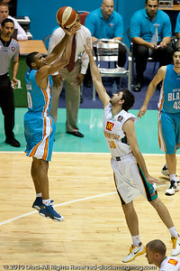 Darryl Hudson over Todd Blanchfield - Gold Coast Blaze v Townsville Crocodiles NBL Basketball, Friday 17 December 2010 - National Basketball League, Gold Coast Convention & Exhibition Centre, Queensland, Australia. Photos by Des Thureson.