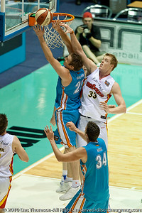 Mark Worthington shoots around Luke Nevill - Gold Coast Blaze v Melbourne Tigers NBL Basketball, Sunday 21 November 2010, GCCEC.