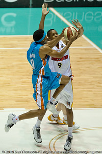 Darryl Hudson over Benny Lewis - Gold Coast Blaze v Melbourne Tigers NBL Basketball, Sunday 21 November 2010, GCCEC.