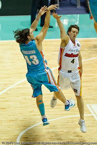 Darryl Corletto closes-out on Chris Goulding - Gold Coast Blaze v Melbourne Tigers NBL Basketball, Sunday 21 November 2010, GCCEC.