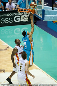Darryl Hudson over Corey Williams  - Gold Coast Blaze v Melbourne Tigers NBL Basketball, Sunday 21 November 2010, GCCEC.