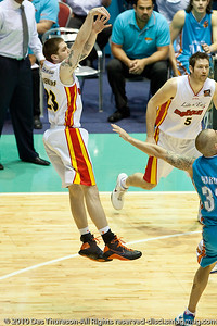 Eric Devendorf shoots over James Harvey - Gold Coast Blaze v Melbourne Tigers NBL Basketball, Sunday 21 November 2010, GCCEC.