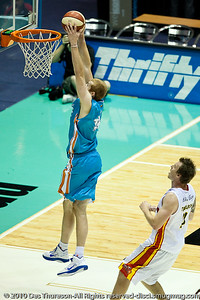 Tom Garlepp gets past Cameron Tragardh for the dunk - Gold Coast Blaze v Melbourne Tigers NBL Basketball, Sunday 21 November 2010, GCCEC.