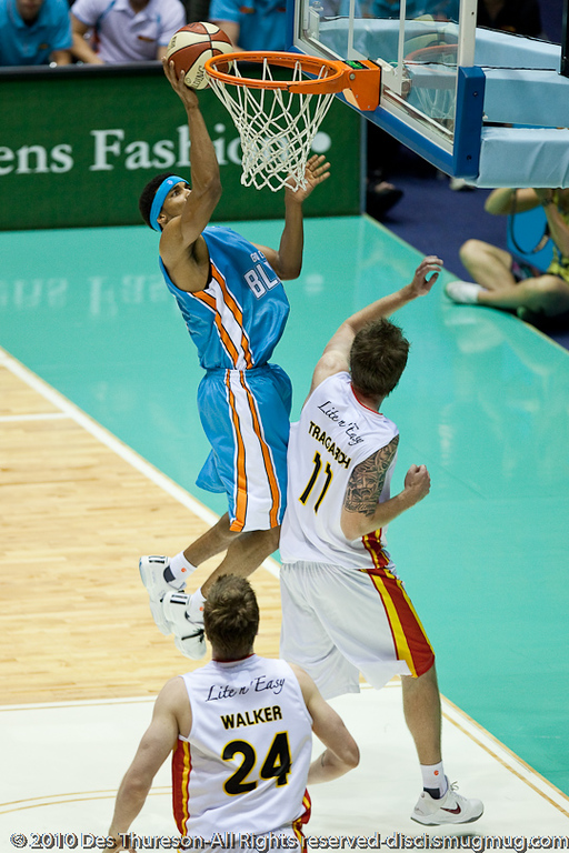 Darryl Hudson over Cameron Tragardh - Gold Coast Blaze v Melbourne Tigers NBL Basketball, Sunday 21 November 2010, GCCEC.