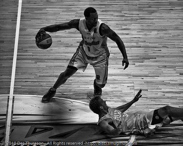 Corey Williams 'literally' over Stephen Hoare - Gold Coast Blaze v Melbourne Tigers NBL Basketball, Sunday 21 November 2010, GCCEC. (Hardcore Acros)