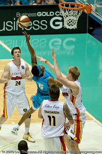 Darryl Hudson tries to make his jump last longer than Luke Nevill's leap - Gold Coast Blaze v Melbourne Tigers NBL Basketball, Sunday 21 November 2010, GCCEC.