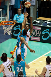 Corey Williams over Darryl Hudson - Gold Coast Blaze v Melbourne Tigers NBL Basketball, Sunday 21 November 2010, GCCEC.