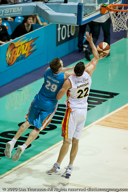 Mark Worthington against Matt Burston - Gold Coast Blaze v Melbourne Tigers NBL Basketball, Sunday 21 November 2010, GCCEC.